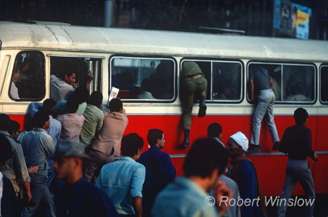 People piling into a Public Bus, Thrir Square,  Cairo, Egypt, Africa
